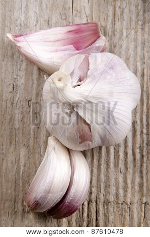 Garlic Closeup On Rustic Wooden Board