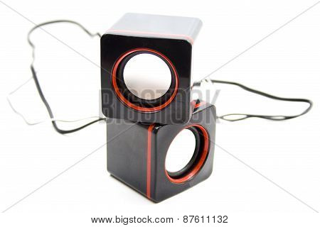 Black Loudspeaker with Cables on white background