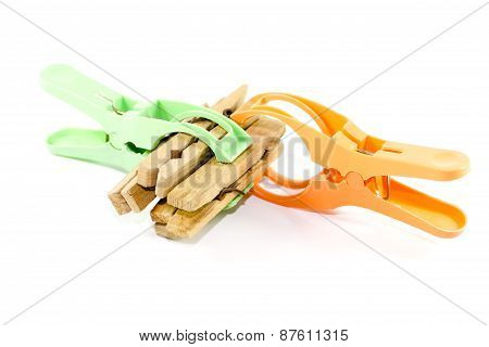 Plastic and Wooden Clothespins on white background