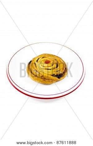 Fresh Baked Pastry with Raisins on plastic Plate