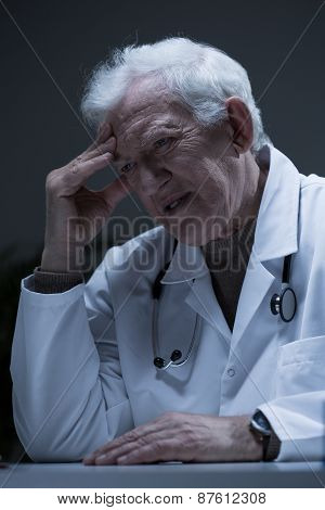 Troubled Senior Doctor