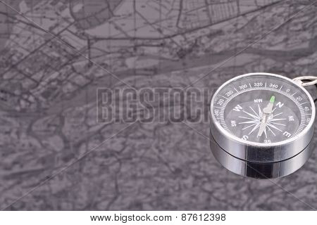 The Compass On The Background Of The Reflection Maps