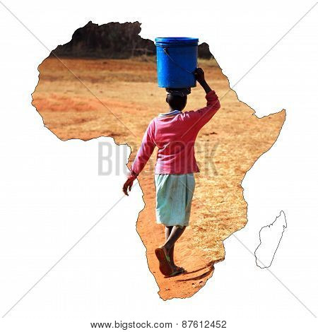 A Young African Girl Carrying A Bucket Of Water On Her Head
