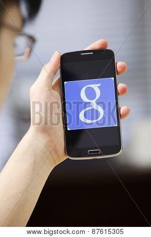 Kuala Lumpur,Malaysia 9th April 2015,Kuala Lumpur,Malaysia 9th April 2015, Young man Using Google Web Search on her Smart Phone.
