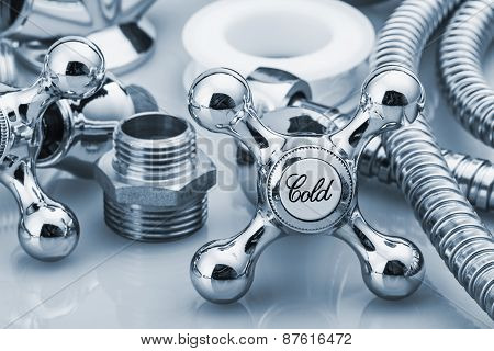 Plumbing And Tools In A Light Background
