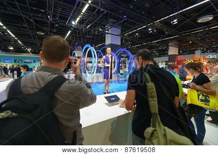 COLOGNE, GERMANY - SEPTEMBER 19, 2014: Samsung stand in the Photokina Exhibition. The Photokina is the world's largest trade fair for the photographic and imaging industries