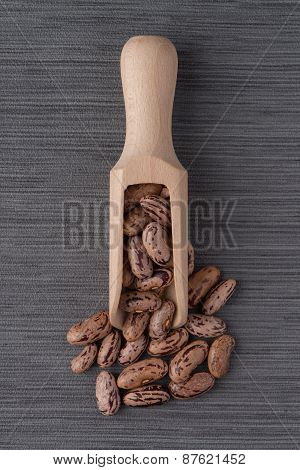 Wooden Scoop With Pinto Beans