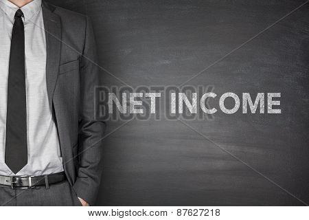 Net income text on black blackboard