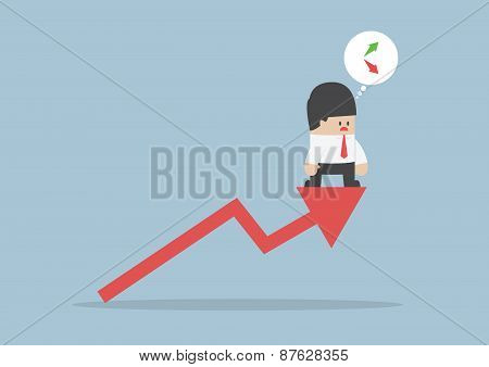 Up Or Down, Businessman Confusing About Stock Market Chart