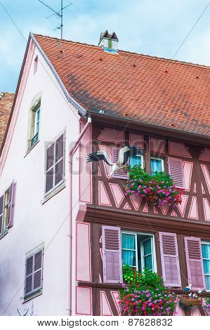 pink half timbered house in alsace