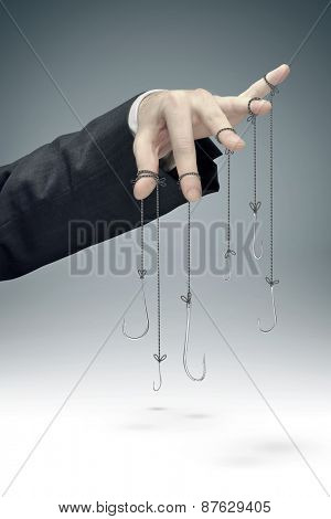 Hooks hanging on businessman hand