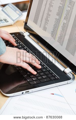 Businessman Working With Laptop At Office Desk