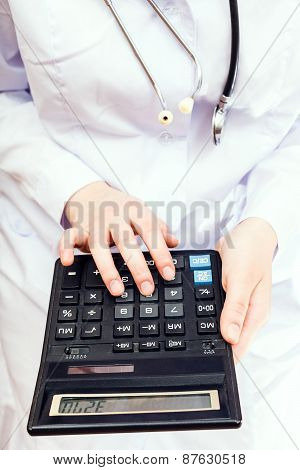 Doctor Calculates The Cost Of Treatment