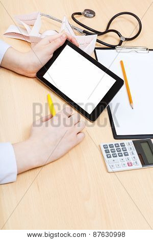 Doctor Calculates On Tablet Pc With Cutout Screen