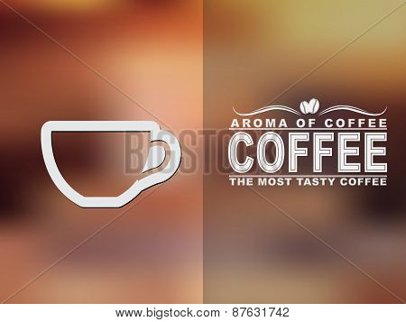 Coffee Cup Icon And Text Design With A Blurred Background.