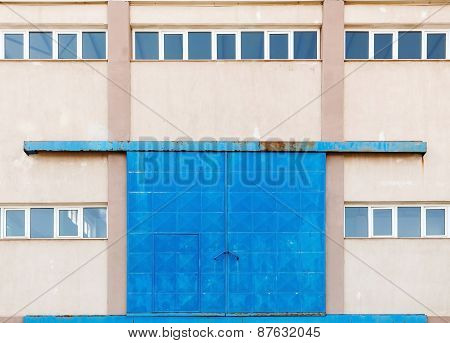 Industrial Wall With Big Blue Closed Metal Gate