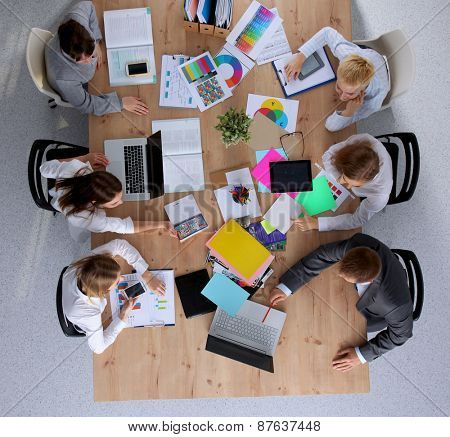 Business people sitting and discussing at business meeting.