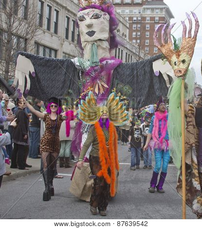 Crazy Costumes And A Large Puppet In The Mardi Gras Parade