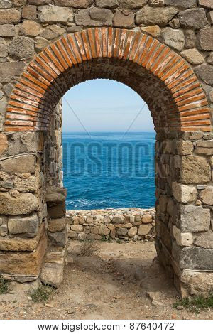 Arch Overlooking The Sea