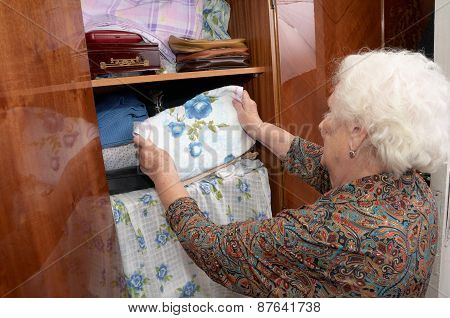 Senior Woman And Wardrobe