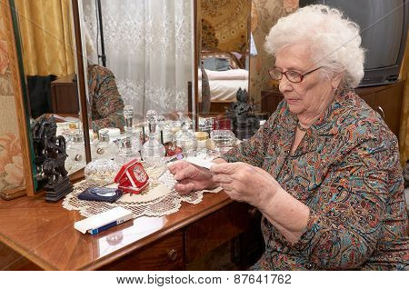 Senior Woman Takes Out Pills