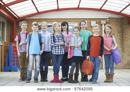 Portrait Of School Pupils Outside Classroom Carrying Bags
