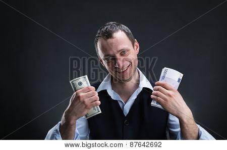 Cheerful businessman with money