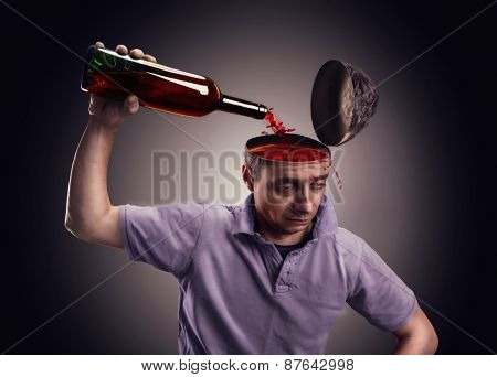Man pours his head on with alcohol