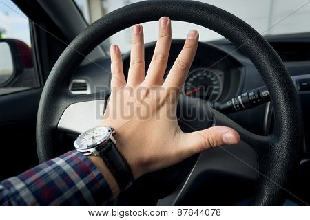 Closeup Shot Of Angry Driver Honking In Traffic