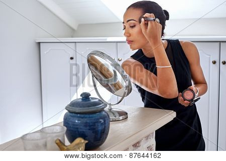 young professional businesswomen applying makeup cosmetics early morning bedroom bathroom at home