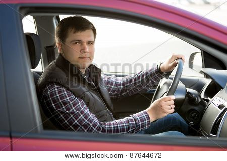Happy Young Man Driving Small Car