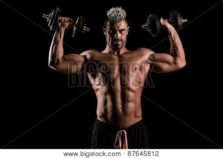 Strong Bodybuilder Man With Perfect Abs, Shoulders,biceps, Triceps And Chest. Powerful Man Lifting H