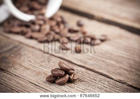 Coffee beans on wooden rustic background