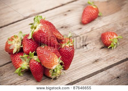 Strawberries on a rustic table