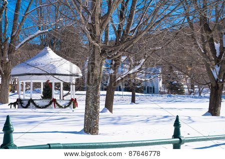 snowy gazebo with holiday decor