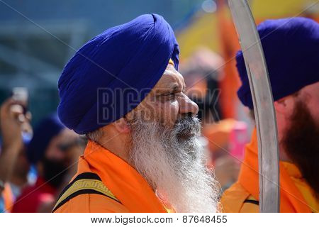 Devotee Sikh With Blue Turban Recite Prayer.