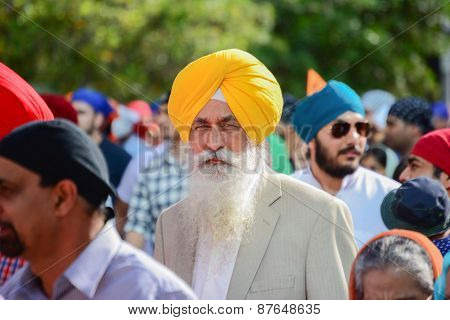 Devotee Sikh With Yellow Turban Marching