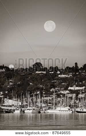 San Diego bay with boat and full moon.