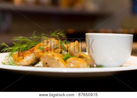 fried chicken wings served with source on white plate