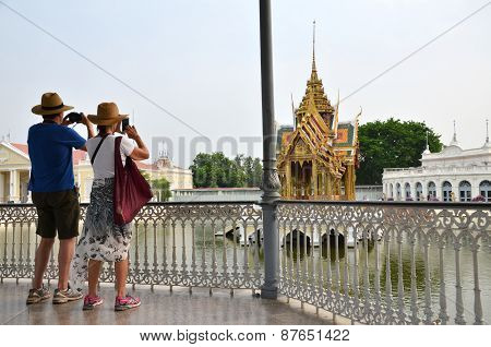 Tourists Take Photo In The Bang Pa-in Palace In Ayutthaya, Thailand