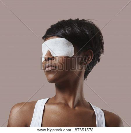 Black Woman Fith A Facial Eye Mask