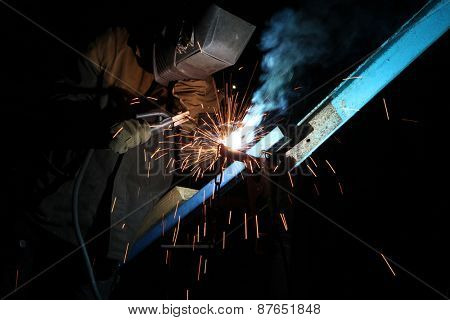 UKRAINE, KIEV - JUNE 6, 2011: Welding operator welds metal constructions in Kiev, Ukraine.