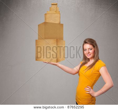 Attractive young lady holding a set of brown cardboard boxes