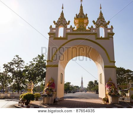 The View Of White Pagoda Of Pratart Phanom Temple From The Arch