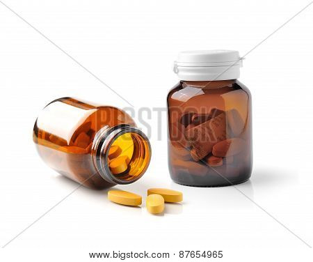 Medicine Bottle Of Brown Glass Isolated On White Background