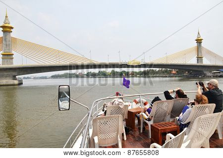 Tourist Enjoy The Sight Of Chao Phraya River In Bangkok