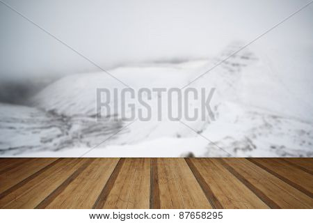 Moody Dramatic Low Cloud Winter Landscape In Mountains With Snow With Wooden Planks Floor