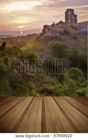 Romantic Fantasy Magical Castle Ruins Against Stunning Vibrant Sunrise With Wooden Planks Floor