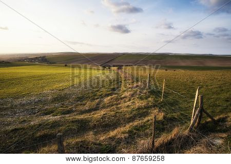 Beautiful Spring Evening Sunset Light Over Fields Landscape On Farm