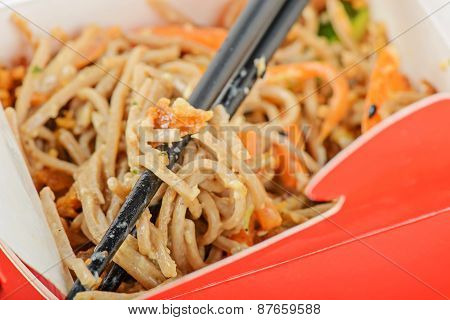 Noodles in red take away container